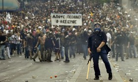 A protestor gestures to police near the