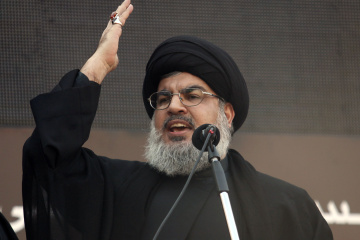 Lebanon's Hezbollah leader Sayyed Hassan Nasrallah addresses his supporters during a religious procession to mark Ashura in Beirut's suburbs