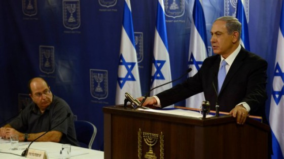 Prime Minister Benjamin Netanyahu speaks at a press conference at the Ministry of Defense in Tel Aviv on July 20, 2014. Defense Minister Moshe Ya'alon looks on. (Photo credit: Haim Zach / GPO/FLASH90)
