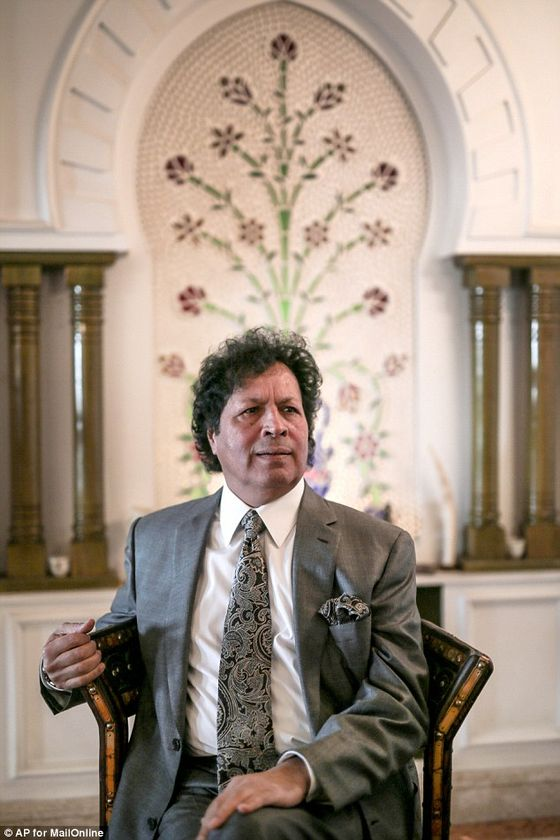 261B308E00000578-2971979-Powerbroker_We_are_working_to_save_Libya_Gaddaf_al_Dam_insists_s-a-16_1425294900596