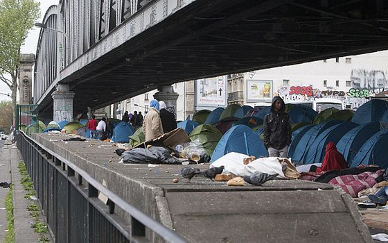 Mandatory Credit: Photo by JDD/SIPA/REX Shutterstock (4715404a)  Hundreds of migrants, mostly from eastern Africa, living in tents under a subway bridge in Paris  Immigrants living in tents under a subway bridge in  La Chapelle, Northern Paris, France - 25 Apr 2015