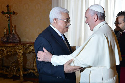 "Pope Francis meets Palestinian leader Mahmoud Abbas during an audience at the Vatican Saturday, May 16, 2015. Pope Francis has praised Palestinian President Mahmoud Abbas as an ""angel of peace"" during a meeting at the Vatican. Francis made the compliment Saturday during the traditional exchange of gifts at the end of an official audience in the Apostolic Palace. (Alberto Pizzoli/Pool Photo via AP)"