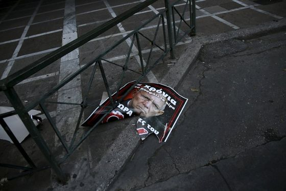 A torn referendum campaign poster depicting German Finance Minister Wolfgang Schaeuble is seen on a street in Athens, Greece, July 3, 2015. An opinion poll on Greece's bailout referendum published on Friday pointed to a slight lead for the Yes vote, on 44.8 percent, against 43.4 percent for the No vote that the leftwing government backs.REUTERS/Alkis Konstantinidis