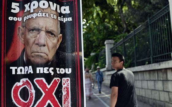 "A pedestrian looks at a poster depicting German Finance Minister Wolfgang Schauble and reading ""5 years he drinks your blood, tell him NO"", ahead of a controversial bailout referendum, on July  2, 2015. The Greek government led by Prime Minister Alexis Tsipras is fiercely campaigning for a 'No' vote, believing rejecting the bailout conditions would strengthen its hand in negotiations with creditors. Greece's radical left government suggested it would resign if it fails to get its way in a make-or-break referendum on July 5 that could decide the country's financial future.. AFP PHOTO/ Louisa GouliamakiLOUISA GOULIAMAKI/AFP/Getty Images"