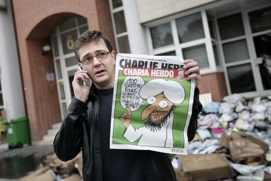 Stéphane Charbonnier, Charlie Hebdo, murdered on January 7 along with many of his colleagues, is shown here in front of the magazine's former offices, just after they were firebombed in November 2011.
