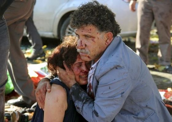 An injured man hugs an injured woman after an explosion during a peace march in Ankara, Turkey, October 10, 2015. REUTERS/Tumay Berkin