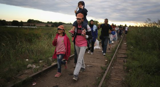 SZEGED, HUNGARY - SEPTEMBER 06:  Migrants and refugees cross the border from Serbia into Hungary along the railway tracks close to the village of Roszke  on September 6, 2015 in Szeged, Hungary.After days of confrontation and choas Hungary unexpectedly opened its borders with Austria allowing thousands of migrants to leave the country and travel onto Germany.  (Photo by Christopher Furlong/Getty Images)
