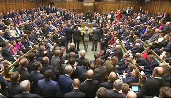 "A video grab from footage broadcast by the UK Parliaments Parliamentary Recording Unit (PRU) shows British Prime Minister David Cameron (C) speaking at the dispatch box in the House of Commons in central London on December 2, 2015 during the debate on a motion to join air strikes on Islamic State (IS) group targets in Syria. Britain's parliament looked set to vote in favour of joining the bombing campaign against the Islamic State group in Syria, despite growing doubts among the public and some MPs. Prime Minister David Cameron, who stepped up pressure for air strikes after last month's Paris attacks, will lead the House of Commons into more than 10 hours of debate on joining the US-led action. RESTRICTED TO EDITORIAL USE - MANDATORY CREDIT "" AFP PHOTO / PRU "" - NO MARKETING NO ADVERTISING CAMPAIGNS - NO RESALE - NO DISTRIBUTION TO THIRD PARTIES - 24 HOURS USE - NO ARCHIVES-/AFP/Getty Images"
