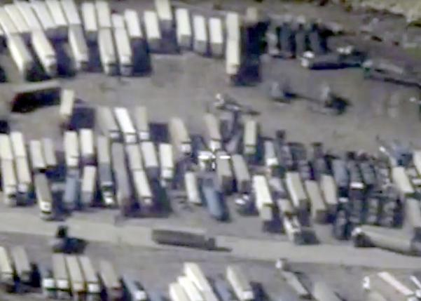 An undated still image taken from a video made available by the Russian Defence Ministry in Moscow, Russia December 2, 2015, shows the Turkish-Syrian border crossing. Russia's defence ministry officials displayed satellite images on Wednesday which they said showed columns of tanker trucks loading with oil at installations controlled by Islamic State in Syria and Iraq, and then crossing the border into neighbouring Turkey.       REUTERS/Russian Defence Ministry/Handout via Reuters