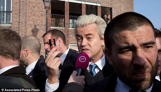 "Firebrand Dutch lawmaker Geert Wilders talks to a TV reporters as he hands out ""self-defense sprays"" to women fearful of being attacked by migrants in the wake of the New Year's Eve sexual assaults in Cologne, in the center of Spijkenisse, near Rotterdam, Netherlands, Saturday, Jan. 23, 2016. Saturday's event was a trademark headline-grabbing foray into the Dutch public by the leader of the Freedom Party. Such publicity stunts have landed him atop Dutch opinion polls a year away from parliamentary elections in the Netherlands. (AP Photo/Peter Dejong)"