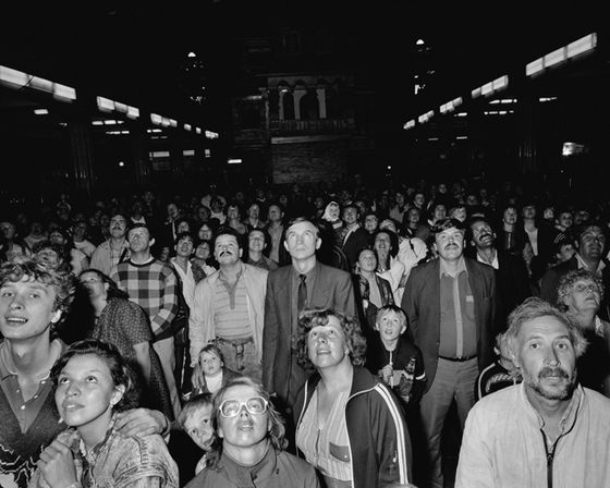 "Russia. Moscow. Dietski Mir. Childrens world. huge toy shop in central Moscow. Crowd waiting for mechanical clock to open. USSR - Homo Sovieticus Days of Glasnost and Perestroika. 1 year in the former Soviet Union. 1988-1989. © Carl De Keyzer - Magnum 1989. Book ""Homo Sovieticus, USSR-1989-CCCP"" 1989."