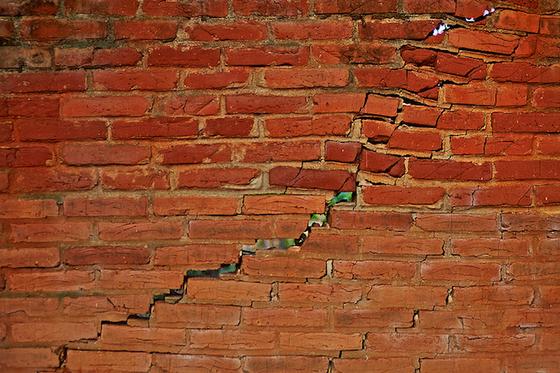 cracked-brick-wall