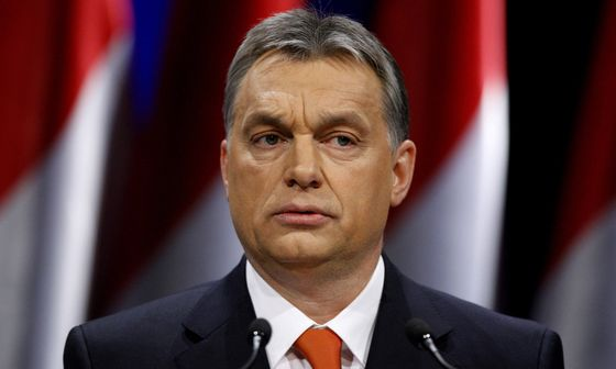 Hungarian Prime Minister Viktor Orban presents his annual state-of-the-nation speech in Budapest, February 22, 2013. Orban said in a state of the nation speech that the country would end its external financial and energy dependence and promised to help all Hungarians out of their crushing foreign currency denominated debts. He used the speech as a campaign platform ahead of elections due in 2014, telling his audience that the opposition served the interests of foreign powers and banks. REUTERS/Bernadett Szabo (HUNGARY - Tags: POLITICS)