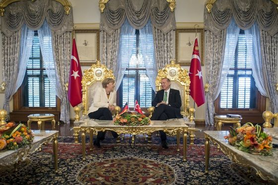 Turkish President Tayyip Erdogan (R) listens to German Chancellor Angela Merkel during their meeting in Istanbul, Turkey, October 18, 2015, in this handout courtesy of Bundesregierung. Germany is ready to help drive forward Turkey's European Union accession process, Merkel said on Sunday, extending support to Ankara in exchange for Turkish help in stemming the flow of refugees to Europe. REUTERS/Guido Bergmann/Bundesregierung/Handout via Reuters ATTENTION EDITORS - THIS PICTURE WAS PROVIDED BY A THIRD PARTY. REUTERS IS UNABLE TO INDEPENDENTLY VERIFY THE AUTHENTICITY, CONTENT, LOCATION OR DATE OF THIS IMAGE. FOR EDITORIAL USE ONLY. NOT FOR SALE FOR MARKETING OR ADVERTISING CAMPAIGNS. FOR EDITORIAL USE ONLY. NO RESALES. NO ARCHIVE. THIS PICTURE IS DISTRIBUTED EXACTLY AS RECEIVED BY REUTERS, AS A SERVICE TO CLIENTS.
