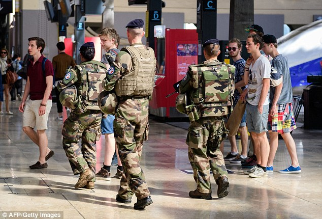 351F605200000578-3642422-Security_forces_patrol_in_and_around_the_gare_de_Marseille_Saint-a-24_1465981539909