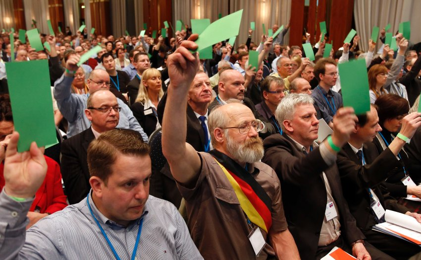Members of the new  anti-Euro  party 'Alternative fuer Deutschland' (Alternative for Germany) cast their vote during the party's founding convention in Berlin, Germany, Sunday, April 14, 2013.  The organizers had to open a second room to squeeze in more than 1,500 members who had come from across the country to adopt a program and vote for a party board. The two spacious halls at the city's upscale Intercontinental Hotel were noticeable filled with lots of gray-haired, elderly men and only few women.  (AP Photo/Michael Sohn)