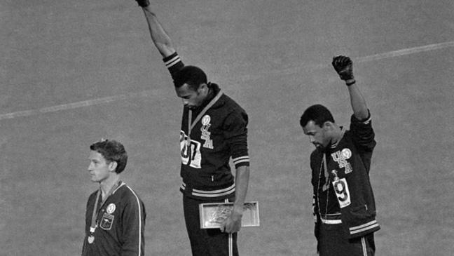 tommie-smith-and-john-carlos-give-the-black-power-salute-on-the-podium-of-the-mexico-city-ollympic-games