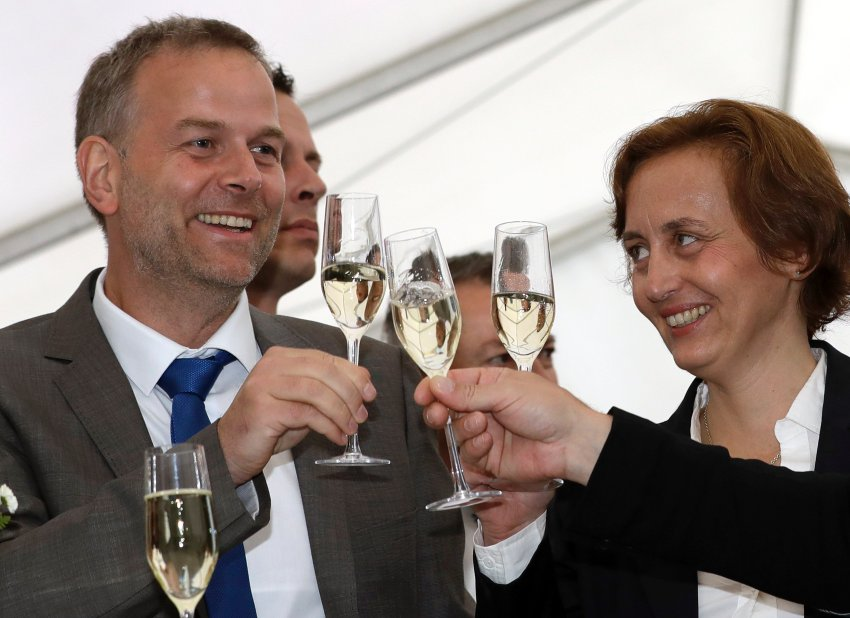 AfD member Beatrix von Storch, right, and Leif-Erik Holm, left, top candidate of the AfD, toast at the gathering of AfD (Alternative for Germany) party in Schwerin, Germany, Sunday, Sept. 4, 2016 after the closing of the state elections in the German federal state of Mecklenburg-Western Pomerania.  Exit polls indicate that the  nationalist, anti-immigration party has performed strongly in a state election in the region where Chancellor Angela Merkel has her political base, likely overtaking her conservative party. (AP Photo/Michael Sohn)