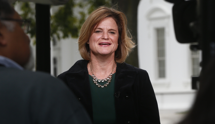 White House communications director Jennifer Palmieri speaks about the government shutdown on the morning television news shows at the White House in Washington, Tuesday, Oct. 1, 2013. Congress plunged the nation into a partial government shutdown Tuesday as a long-running dispute over President Barack Obama's health care law forced about 800,000 federal workers off the job, suspending all but essential services. (AP Photo/Charles Dharapak)