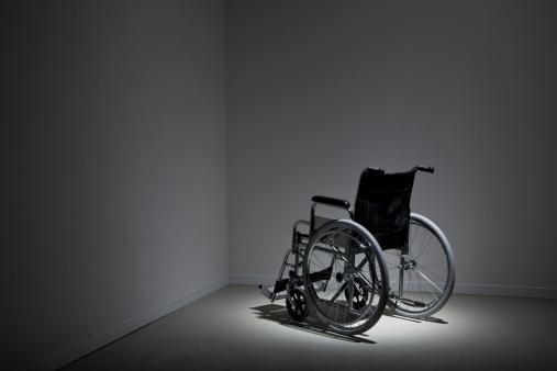 Empty wheelchair in a corner