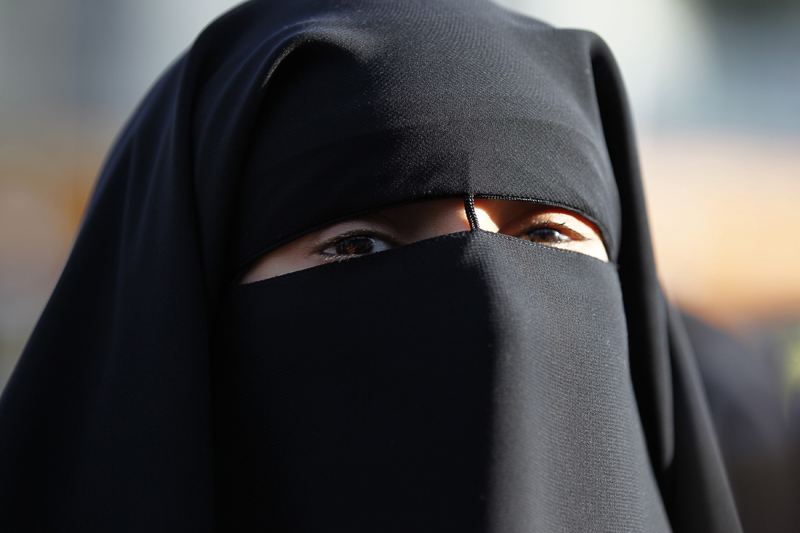 Hind Ahmas wears a niqab despite a nationwide ban on the Islamic face veil outside the courts where she arrived with the intention to pay a fine after she was arrested last May for wearing the niqab in public, in Meaux, east of Paris, on September 22, 2011. Photo courtesy of REUTERS/Charles Platiau *Editors: This photo may only be republished with RNS-FRANCE-NIQAB, originally transmitted on Oct. 20, 2015.