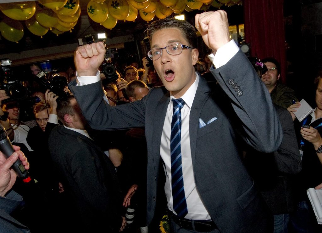 epa02345103 Jimmie Akesson, chairman of the right-wing party Sweden Democrats, cheers when he meets party workers in Stockholm, Sweden, 19 September 2010, after forecasts of the national elections saying the Sweden Democrats will enter the new Swedish parliament. EPA/FREDRIK SANDBERG SWEDEN OUT