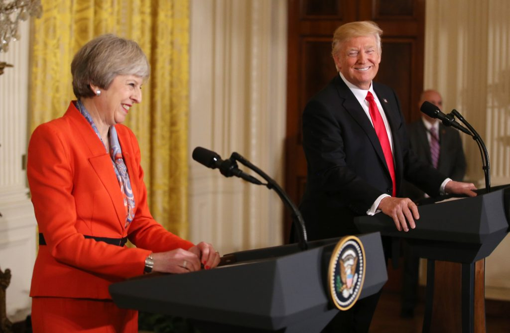 U.S. President Donald Trump and British Prime Minister Theresa May smile as they hold a joint news conference at the White House in Washington, U.S., January 27, 2017. REUTERS/Carlos Barria TPX IMAGES OF THE DAY